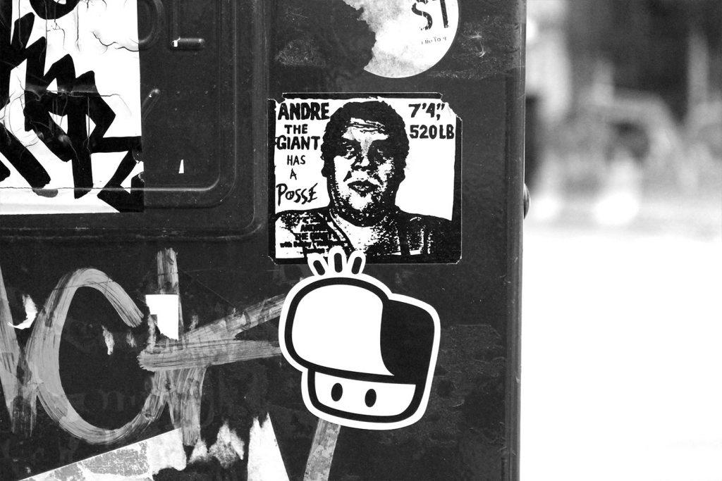 Street art New York City The Hat Kid OBEY