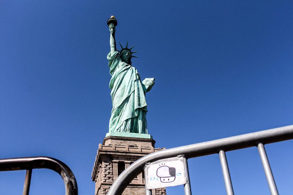 Street art New York City The Hat Kid Statue of Liberty