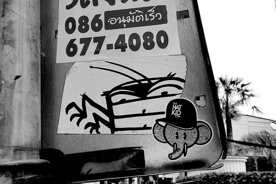 the hat kid street art Thailand stickers ZAM ART